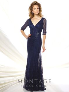 116932 - Lace slim A-line gown with illusion lace three-quarter length sleeves, front and back wide V-necklines, surplus bodice with hand-beaded motif at side, slim skirt with side draped lace overskirt, sweep train. Removable modesty piece included.