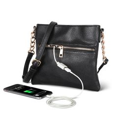 The Phone Charging Purse - This is the crossbody purse with a built-in backup battery that charges a smartphone or tablet from within an exterior pocket. The ultra-thin rechargeable 3,000 mAh battery pack has a 1.0 amp USB port that provides enough juice to restore a dead smartphone to full charge.