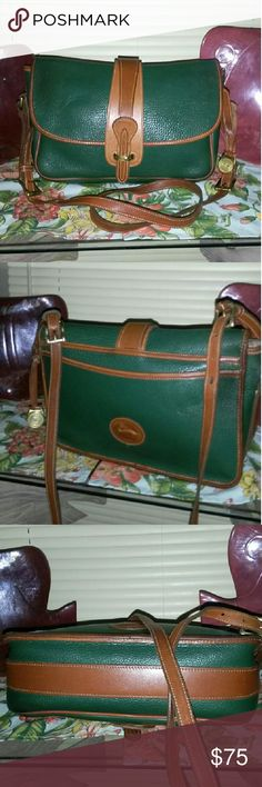 Dooney & Bourke VINTAGE pre tag era Equestrian Wow! This Fir Green Vintage bag doesn't have a scratch or wear on her. Piping perfect, leather perfect AWL PEBBLED LEATHER PERFECT!  She has been well taken care of. She has her original dbl buckle strap which was only on the very old 1980 models and the original pre tag era brass fob still attached! She is Beautiful! 10.5 in x 8in, Adjustable 24.in strap drop Dooney & Bourke Bags Crossbody Bags