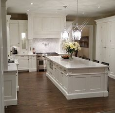 I'm starting to think about a longitudinal island, similar to this, running lengthwise East-West. So you enter the kitchen looking at the short end of the island. Chairs along the RHS guide guests away from the cooking area to the LHS. Kitchen Redo, Home Decor Kitchen, New Kitchen, Kitchen Remodel, Kitchen Design, Kitchen White, Kitchen Island No Sink, Kitchen Ideas, Luxury Kitchens