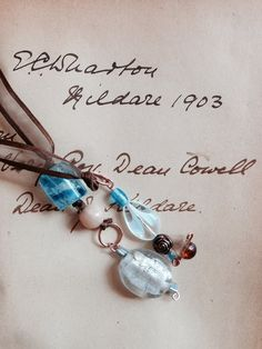 Book mark brown, blue, copper findings and ribbon