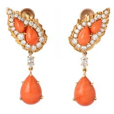 CARTIER Rare Coral Earrings, France, Circa 1960s~ A stunning pair of Cartier, Paris, 18kt yellow gold, salmon colored coral & diamond pendant earrings.