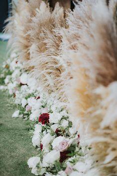 www.littlehillfloraldesigns.com Wedding flowers, Southern California Garden wedding lush roses and pampas grass with pops of Burgundy dahlias