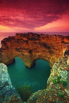 The photo above features the Heart Sea Arch in Portugal. Although the sea isn't really heart-shaped, the natural heart photography makes it a must-visit place in Portugal. What A Wonderful World, Beautiful World, Beautiful Scenery, Beautiful Hearts, Beautiful Rocks, Beautiful Pictures, Amazing Photos, Simply Beautiful, Beautiful Beaches