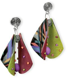 Arden Bardol takes two flat pieces of polymer, adds surprises on both sides and dots one side with color. She backs the two curved pieces against each other separating them with polymer stoppers.  Voila! Earrings that will have everyone studying them as they twist and sway. Even the space between
