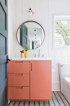 A round mirror hangs from a vertical shiplap wall beneath a pale pink vintage sconce and over an orange bath vanity finished with a white quartz countertop and a chrome gooseneck faucet. Home Room Design, Bathroom Interior Design, Room Ideas Bedroom, Bedroom Decor, Aesthetic Room Decor, My New Room, House Rooms, Diy Home Decor, White Bathroom