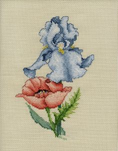 Blue Iris and a Poppy.  I cross stitched this on vinyl-weave 14 count cross stitch fabric for a 3 ring binder cover.