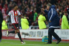Patrick van Aanholt of Sunderland celebrates scoring his team's opening goal with manager Sam Allardyce during the Barclays Premier League match between Sunderland and Everton at the Stadium of Light on May 11, 2016 in Sunderland, England.