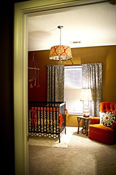 warm corporate nursery. orange chair!