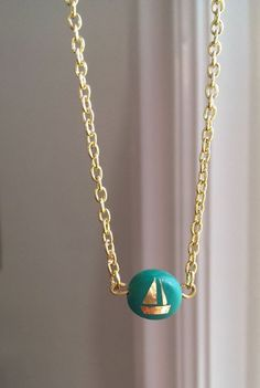 mad mim // polymer class and gold foil sailboat pendant necklace