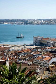 From the top of an hill - a boat slides in the Tagus River - Lisbon, Portugal Places Around The World, The Places Youll Go, Great Places, Places To See, Around The Worlds, Amazing Places, Visit Portugal, Spain And Portugal, Portugal Travel