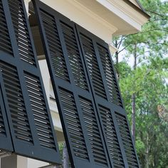 Showing contrasting dark shutter option, but like the lighter wood better- think it will be unique yet timeless and match the houses architecture more-- Aluminum Bahama Shutters.jpg (406×406)