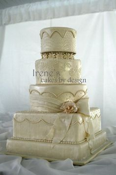 Ashley , Luster Fondant cake with  Sugar Gardenia and bow, lace designs and dotted Swiss