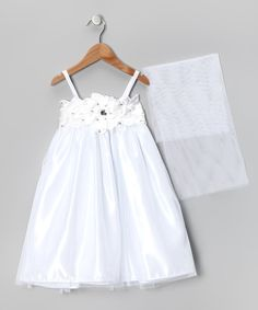 Satin fabric, a tie waist and a shawl make this tiered ruffle dress a standout hit. With an easy-on back zipper and soft lining, this fabulous frock pretties up any little princess.Includes dress and shawl100% polyesterMachine wash; tumble dryMade in the USA