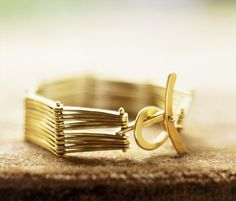 """""""honey"""" hinged 19K gold bracelet designer: jill platner"""