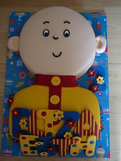 Caillou A Caillou cake for Elizabeth, 2 years old. This is a marble cake with chocolate ganache covered with fondant and fondant accents.