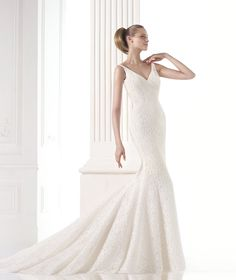 The New Design Delicate mermaid wedding dress with a lace bodice, skirt and train. Bodice with V-neckline and plunging back.  Free Measurement
