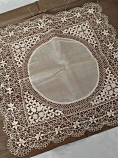 Here is a gorgeous Victorian silk thread hand made bobbin lace handkerchief. The lace making design is a combination of wheat or leaves mixed with other filling stitches. The color is a cream ivory,