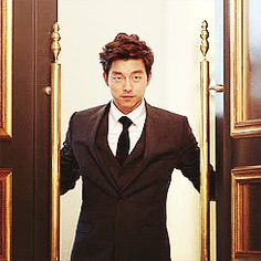 Gong Yoo in a suit gif. Man knows how to make an entrance.