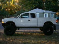 White Dodge Dakota Lifted