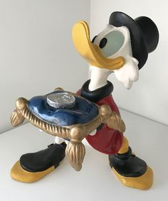 SCROOGE MCDUCK HOLDING COIN ON PILLOW LARGE RESIN FIGURE BY DISNEY