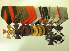 Set of ten orders belonging to Nikolay II, among them French Croix de Guerre with swords, (1915); Denmark Badge of the Order of Daneborg (the Danish flag), and Greece Badge of the Order of the Saviour. Click for a full list
