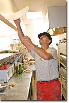 Tossing Pizza Dough Into The Air May Be Critical To The Art Of Making A Perfect