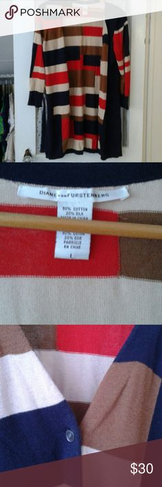 Diane Von Furstenberg color-blocked long cardigan The Bold and Beautiful color block sweater by Diane Von Furstenberg. Shades of tan and brown with navy and red. Hit blank sweater with bracelet length sleeves. Some minor pilling on one side, but an overall good condition. 80% cotton 20% silk. Diane von Furstenberg Sweaters Cardigans