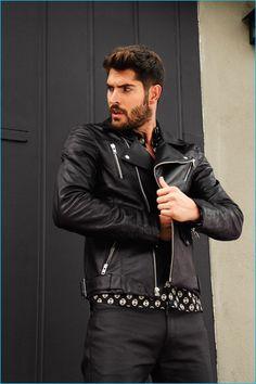 Nick Bateman plays it cool in a leather biker jacket.