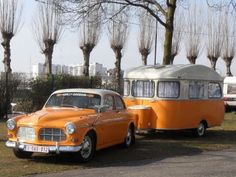 Orange and white car and camper
