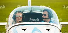 Woman and man pilot looking at camera, preparing for flying