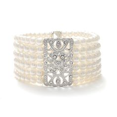 Beautiful 6 row ivory pearl bracelet has a beautiful vintage etched design with cz crystals. This top-selling bridal stretch bracelet is 1 w. Perfect for brides, bridesmaids and all Silver plated, faux pearls, cz crystals. Lauren's chic boutique L 427 202 Bridal Cuff, Bridal Bracelet, Pearl Bracelet, Pearl Bridal, Wedding Bracelets, Bridal Bangles, Vintage Bracelet, Bridal Earrings, Handmade Wedding Jewellery