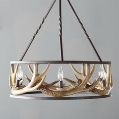 Learn To Decorate In A Creative Rustic Lighting Ideas It can be a complicated process for some people to tackle a project of home interior design. Cabin Chandelier, Deer Antler Chandelier, Antler Lights, Wagon Wheel Chandelier, Chandelier Lighting, Antler Crafts, Antler Art, Rustic Lighting, Cabin Lighting