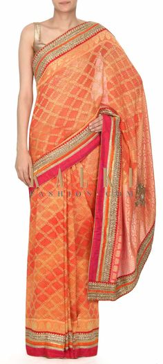 Buy this Peach and orange saree with bandhani print only on Kalki