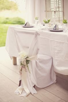 Your chairs don't have to be white - they just have to be covered! Love how they used an over-sized cover with a ribbon here! Would look great at #DinerenBlancCHI