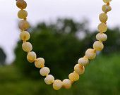 Raw white Baltic Amber teething necklace for baby - Maximum pain relief