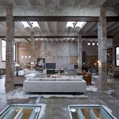Love the exposed brick and old warehouse feel. Contemporary, yet rustic.