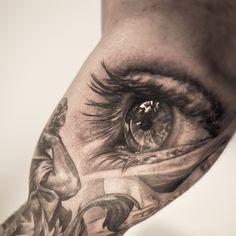 Eye, bicep tattoo on TattooChief.com