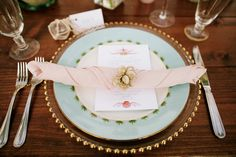 Place Setting on Wooden Farm Table with Gold Beaded Charger, Dinner Plate, Rolled Blush Hemstitch Napkin & Thank You Card