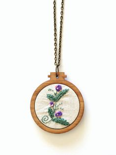 Mini Embroidery Hoop wooden pendant by BleuRoo Stitchery, click through to see more awesome embroidered pendants!!