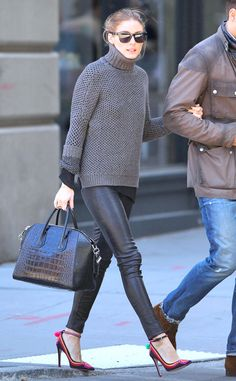 pstrongOlivia Palermo/strong pairs a chic gray turtleneck with leather pants and tri-colored ankle strap pumps, while out and about in New York./p