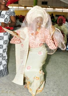 Traditional Nigerian wedding, bride in wearing a Gele (gorgeous head wrap).