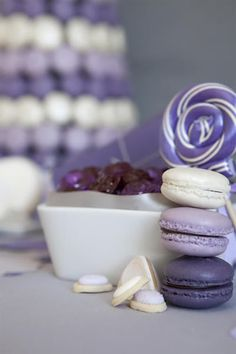 purple macaron cookies. never have had or made these, except one time at an engagement party. but looove the look for a purple theme. sophisticated and sweet!