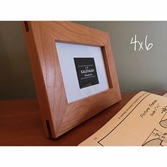 4x6 Handmade Picture Frame - Cherry wood with Walnut Splines - Wooden - Glass - (Single). From the precision woodworking to the hand-cut glass, this is a 100% handmade, furniture-quality, wood and glass picture frame. This frame is made from cherry hardwood and finished with four hand-applied layers of finish-the same finish that I use on fine furniture. A typical miter joint (45 degree joints at corners) is very weak due to the end-grain gluing surfaces. To make this frame last…