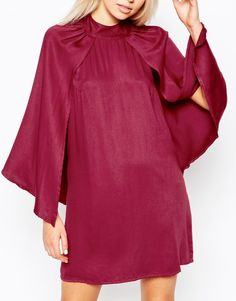 Amy Childs matches her maroon hair to a cape dress in London   Daily Mail Online