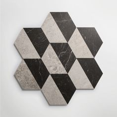 Inspired by the architecture of New York, the new Gramercy Park collection offers a versatile range of marble slab, tiles and décors. It includes contemporary marble tiles in eye-catching geometric patterns alongside plain honed surfaces. Available in a palette of 3 colourways – ivory, soft grey and veined black, the collection is designed as a suite of surfaces to be used in combination or individually. Slab options, ideal for skirtings, architraves, vanities and shower trays also available. Black Marble Tile, Marble Games, Gramercy Park, Architrave, Tiles, Stone, Antiques, Grey, Geometric Patterns