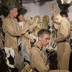 the_ww2_memoirs Fighter pilots get the call to scramble and put on their gear after getting the word that their on a mission to do a bombing run on Manila aboard the aircraft carrier USS Ticonderoga (CV-14), 5th of November, 1944. In today's caption I wil http://www.deepbluediving.org/