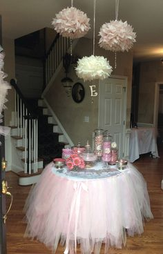 in foyer right when you walk in, candy bar and paper poms. Pink tutu table skirt
