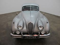 1956 Jaguar XK140 Fixed head coupe, silver with red interior, beautiful color combination, overdrive, wire wheels, very presentable weekend driver and an original California car that is mechanically sound. For $39,500      If you have any additional questions Please call 310-975-0272 or email with any questions! We also welcome all international buyers. We can help with shipping quotes and arrangements.
