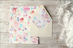 A pretty way to add a personal touch to simple stationery: a custom watercolor illustration in your own colors to scan, print and use as envelope liners.